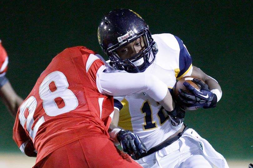 Whitmer-wins-semifinal-tackle