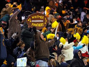 Whitmer High School fans cheer on their Panthers.