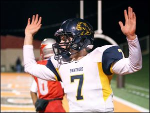 Whitmer High School quarterback Nick Holley celebrates his first quarter touchdown.
