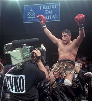 "Hector ""Macho"" Camacho being lifted into the air after his unanimous decision over Roberto Duran in an IBC middleweight title fight at the Trump Taj Mahal Casino Resort June 22, 1996 in Atlantic City, N.J."