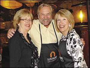 Janet Robinson, Richard LaValley and Mary Arquette are pleased with the success at Lourdes University Celebrity Wait Night.