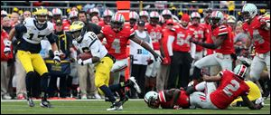 Michigan's Denard Robinson breaks away for a 68-yard touchdown run.