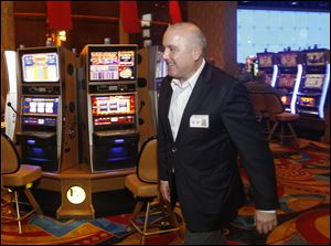 General Manager Richard St. Jean strolls through Hollywood Casino Toledo. He is upbeat about the casino's future despite declining revenue since June.