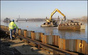 Dredging the Maumee River at the Ironville Dock site in East Toledo has a target of providing a water depth of 27 feet. The dock site is at the former Gulf Oil refinery along Front Street.