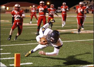 Whitmer High School quarterback Nick Holley, 7, dives into the end zone.