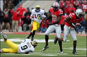 Ohio State safety C.J Barnett intercepts a Michigan pass late in the game.