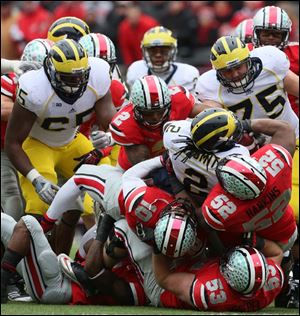 The Ohio State defense takes down Michigan's Rod Smith during the third quarter.