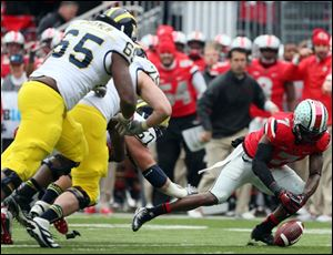 Ohio State cornerback Travis Howard recovers a fumble by Michigan's Devin Gardner in the fourth quarter.