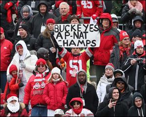 Ohio State fans cheer the victorious and undefeated Buckeyes.