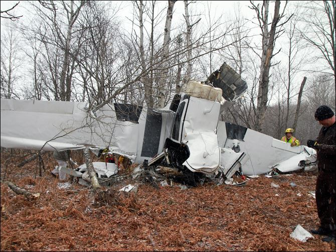 Authorities review the scene of a fatal plane crash in Mancelona, Mich., 140 miles north of Grand Rapids, Mich. Authorities found the wreckage of the Cessna 310B and the body of the pilot, Roger Crawford, 68, Friday after he missed a family gathering on Thanksgiving in Frankfort, Mich.