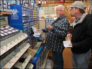 Mills Hardware salesman Mike Stock, left, helps customer Tom Rectenwald, Jr., at the Perrysburg store on Small Business Saturday.