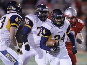 Whitmer player Marcus Elliott, 24, runs back an interception during the fourth quarter.