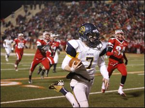 Whitmer quarterback Nick Holley, 7, heads for the end zone on a long run beating Mentor High School during the fourth quarter.