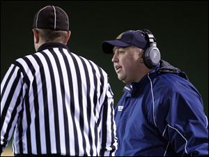 Whitmer coach Jerry Bell questions a call that goes against the Panthers during the first quarter.