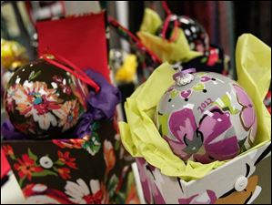 Christmas ornaments sit on display at Lady C during Small Business Saturday in downtown Sylvania.