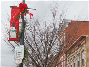 Street lamps are decorated for the holiday season on Louisiana Avenue in Perrysburg.