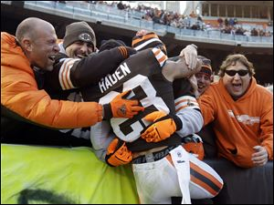 Cleveland Browns cornerback Joe Haden (23) is hugged by fans after a 20-14 win over the Pittsburgh Steelers in an NFL football game today.