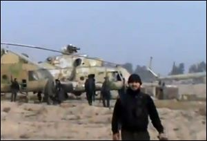 Syrian rebels capture a helicopter air base near the capital Damascus after fierce fighting in Syria.