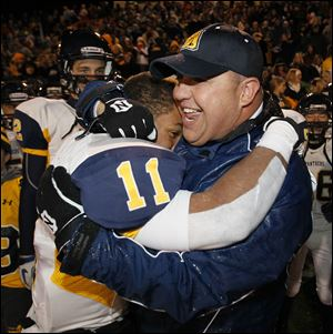 Whitmer's Me'Gail Frisch hugs head coach Jerry Bell after the Panthers defeated Mentor to advance to the state final.