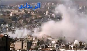 In this image taken from video obtained from the Shaam News Network, smoke rises from buildings due to government shelling in the Damascus suburb of Zabadani, Syria, on Friday.