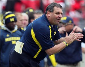 Michigan head coach Brady Hoke saw his Wolverines lose 26-21 to Ohio State on Saturday in Columbus. Bowl-schedule practices will give UM time to sharpen its two-quarterback system and a win against a good opponent in a holiday bowl game might change the last impressions of this team.
