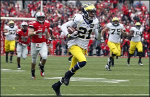 Michigan wide receiver Roy Roundtree scores a first-quarter touchdown against Ohio State on Saturday in Columbus.  He three passes for 92 yards and a touchdown in a 26-21 loss.