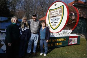 Project coordinator Bill Saul gathers with volunteers who helped paint and decorate the national battlefield park float that will appear in Ida's Parade of Lights. From left are Darlene Belair, Becky Mullins, and Sandy Vanisacker. More than 120 floats are expected to be in the parade.