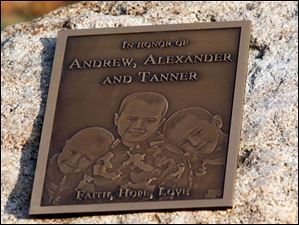 The plaque unveiled during a ceremony honors the missing boys with their likenesses.