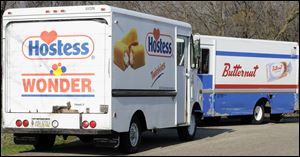 Trucks are parked at the Hostess bakery outlet  in Kalamazoo Township, Mich.