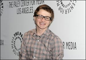 Actor Angus T. Jones arrives at the Paleyfest panel discussion of the television series
