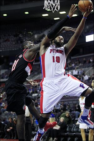 Detroit Pistons center Greg Monroe (10) is fouled by Portland Trail Blazers center J.J. Hickson (21) during the third quarter of an NBA basketball game at the Palace of Auburn Hills, Mich., Monday, Nov. 26, 2012. (AP Photo/Carlos Osorio)