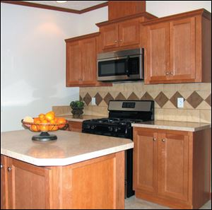 The kitchen boasts an attractive work island and all-new Frigidaire appliances.