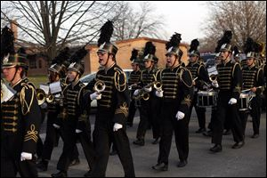 The Perrysburg High School marching band makes its way down Elm Street during the parade. Mayor Nelson Evans said the 'Home for the Holidays' theme of the event brought out togetherness.