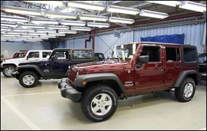 Jeep Wranglers are lined up at the Chrysler Toledo Assembly Complex.