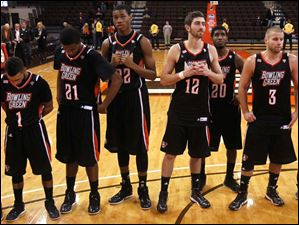BGSU players from left: Jordon Crawford, Chauncey Orr, Richaun Holmes, James Erger, Jehvon Clarke, and Luke Kraus, stand during the alma mater after the game.