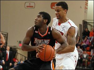BGSU's Jehvon Clarke is guarded by Jermaine Lippert during 2nd half.