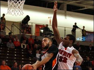 BGSU's five-foot-six Jordon Crawford doesn't let the size of Anton Wilson, 6-5, stop him from driving to the basket.