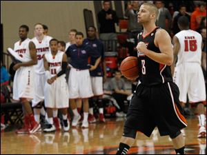 BGSU's Luke Kraus holds the game ball as the buzzer goes off, giving BGSU the win.