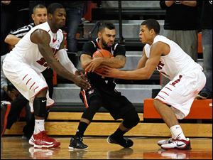 BGSU's Jordon Crawford guards the ball from Detroit's Doug Anderson, left, and Ray McCallum with about 1 minute remaining in the game.