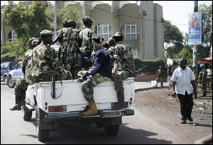 M23 rebels patrol around Congo's Central Bank in Goma, eastern Congo, Monday.