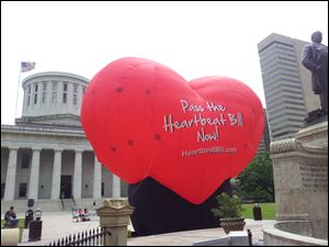 A large balloon in support of the Heartbeat Bill is seen in front of the Ohio statehouse.