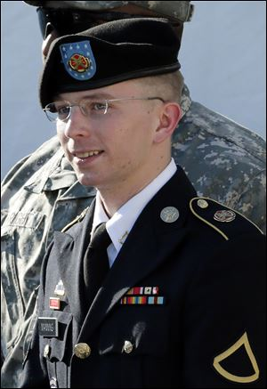 Army Pfc. Bradley Manning is escorted out of a courthouse in Fort Meade, Md., after a pretrial hearing.