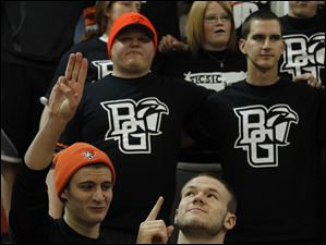 Fans sing the Alma Mater and the fight song 'Forward Falcons' after BGSU defeats Detroit-mercy at the Stroh Center.