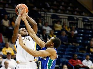 University of Toledo guard Rian Pearson takes a shot against Texas A&M-Corpus Christi guard Johnathan Jordan (10).