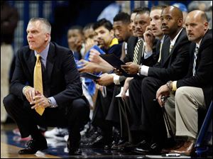 University of Toledo head basketball coach Tod Kowalczyk gives instructions.