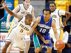 Toledo guard Rian Pearson defends against Texas A&M-Corpus Christi guard Johnathan Jordan.