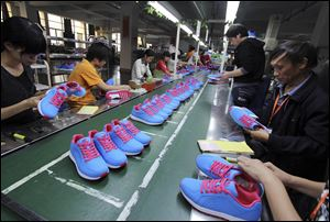 Chinese-made goods such as these shoes would be less desirable than U.S.-made counterparts to China's prospering middle and upper classes, said Paul Zito of the Regional Growth Partnership.