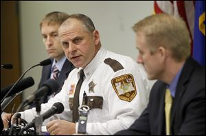 Morrison County Sheriff Michel Wetzel speaks at a news conference Monday, in Little Falls, Minn.
