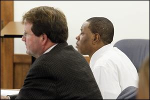 Daurin Patton of Toledo, right, and his attorney, Merle Dech, listen to court proceedings on the third day of Patton's murder trial in Lucas County Common Pleas Court. He is accused in the shooting deaths of Veronica Serrano and her son Timothy Blair, 14.