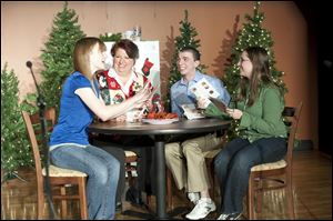 Cast members in the 2011 production of  Uh Oh Here Comes Christmas are, from left, Kelly Fandrey, Paula Larsen, Tom French, and Megan Carter.